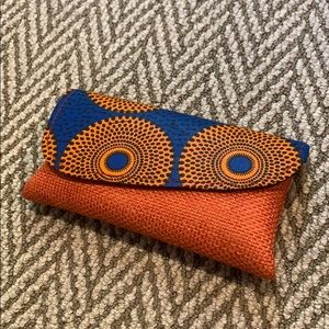 Artisan orange and blue clutch